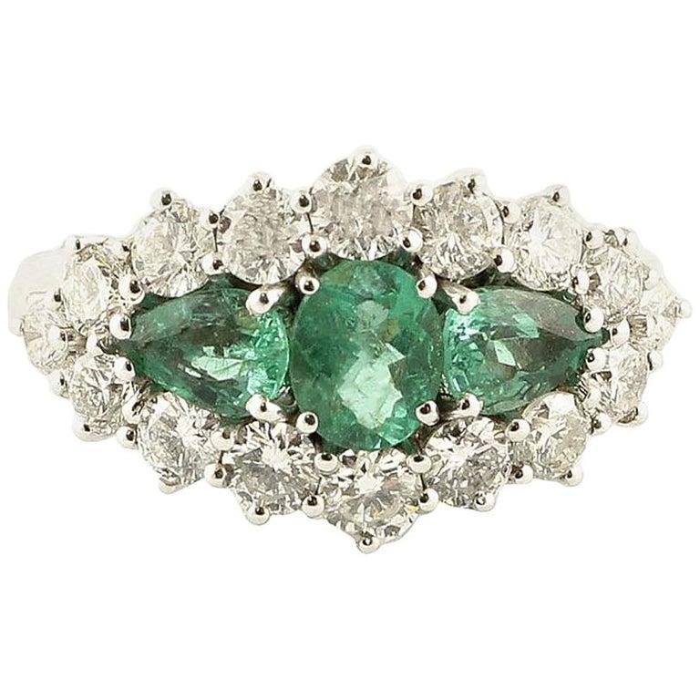 1.25 Carat Emeralds 1.72 Carat White Diamonds White Gold Ring For Sale