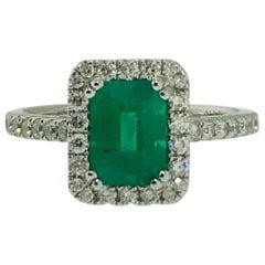 1.25 Carat Genuine Emerald and .50 Carat Diamond Halo Engagement Ring, 18 Karat