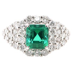 1.25 Carat Natural Emerald and Diamond Ring Set in Platinum