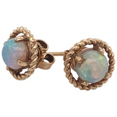 1.25 Carat Natural Opal Stud Earrings Framed with Ropes of 14 Karat Yellow Gold