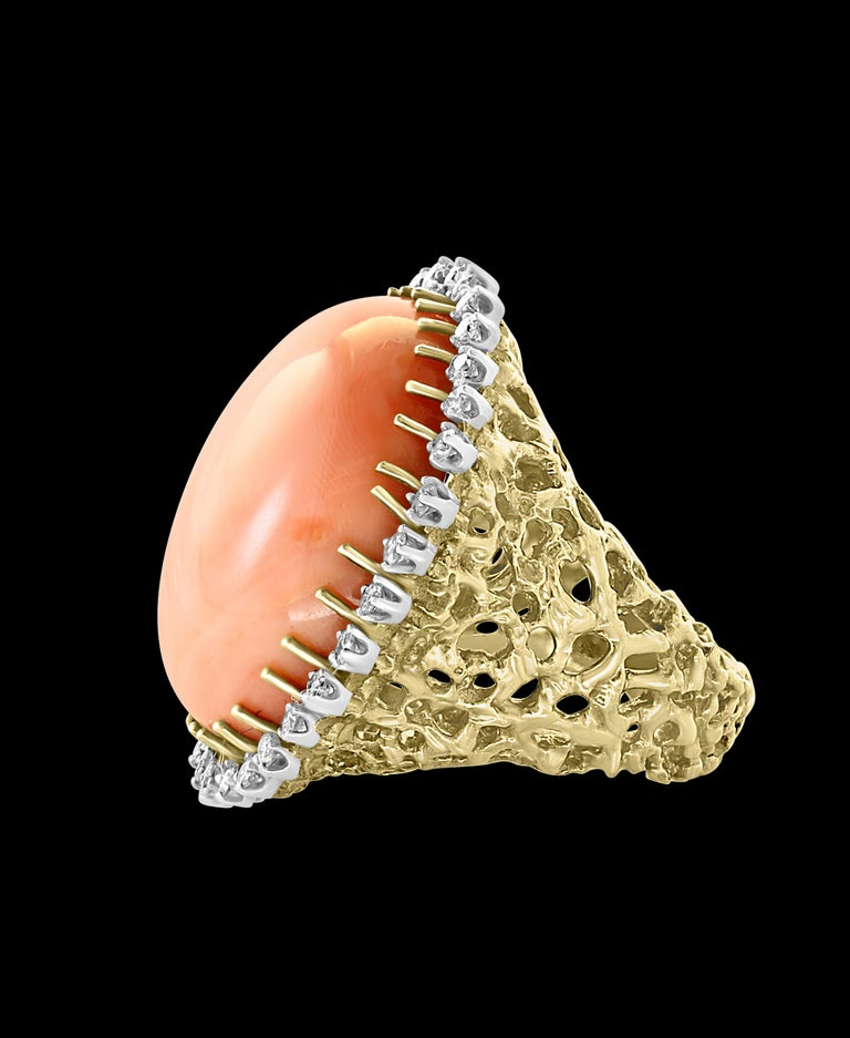 125 Carat Natural Pink  Round Coral Cocktail Ring   with Diamonds all around the stone  18 Karat Yellow Gold Estate  A classic, Cocktail ring  Huge 125 Carat of very clean no inclusion  Pink Coral in round shape , full of luster and shine  and