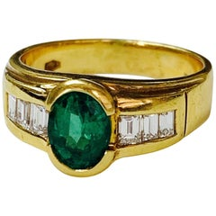 1.25 Carat Oval Emerald and Diamond Engagement Ring in 18 Karat Yellow Gold