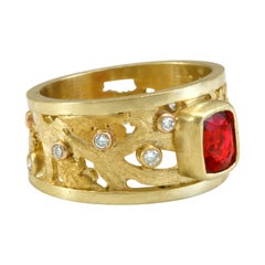 1.25 Carat Red Spinel with .27 Carat Diamonds Set in 18k Gold Scrollwork Band