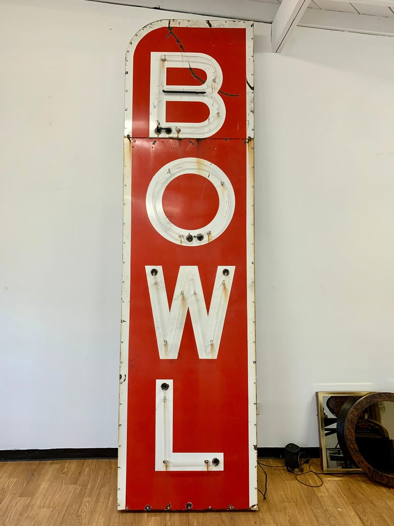 Massive 12.5 foot tall metal and neon bowling sign from the 1960s. Sign is red with white letters and white trim. Neon lights are red and illuminate letter by letter B - 0 - W - L and then blinks off and starts over. Sign was hanging for years at a