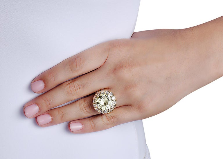 This estate cocktail ring signed by Nardi features a 12.50 carat round brilliant O-P color VVS clarity center stone set in 18K yellow gold with rectangular and square baguette cut diamonds. *The central stone looks whiter than in pictures*  Made in