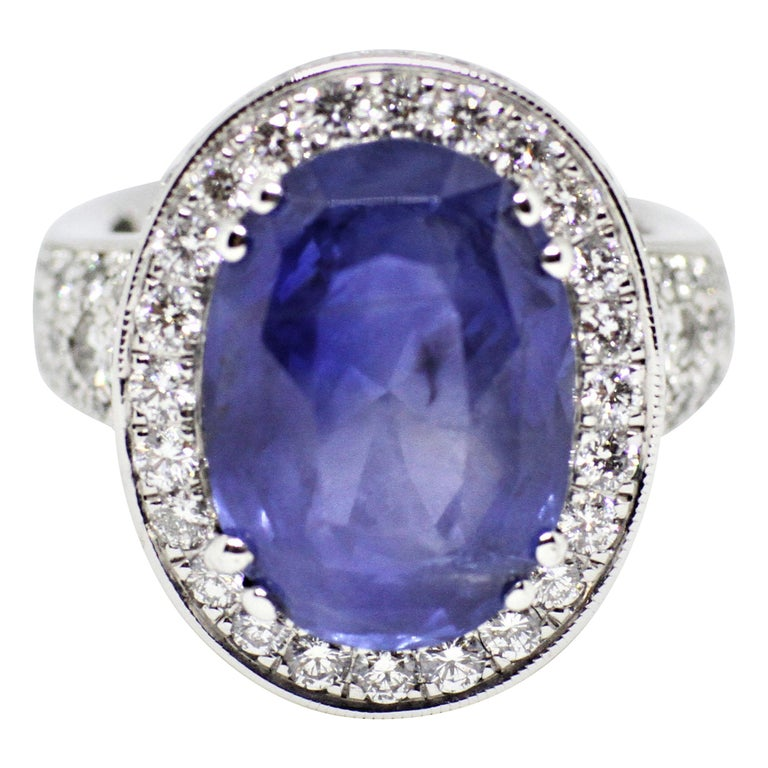 12.59 Carat Natural Oval Blue Sapphire and Diamond 18 Carat Gold Cocktail Ring For Sale