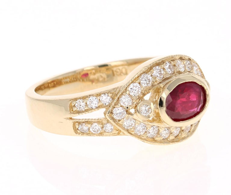 Simply beautiful Ruby Diamond Ring with a Oval Cut 0.68 Carat Burmese Ruby which is surrounded by 34 Round Cut Diamonds that weigh 0.58 carats. The total carat weight of the ring is 1.26 carats. The clarity and color of the diamonds are SI2-F.   The