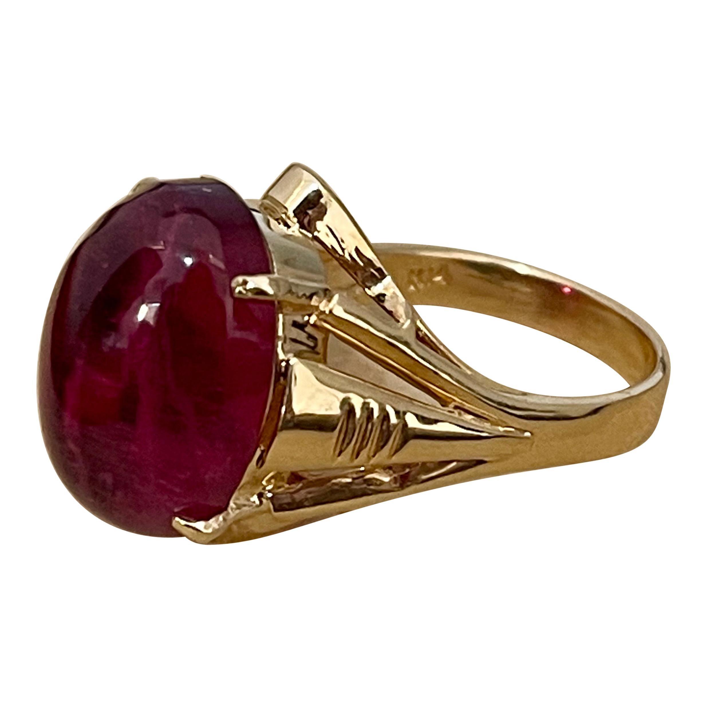 12.6 Carat Oval Cut Cabochon Pink Tourmaline 14 Karat Yellow Gold Ring