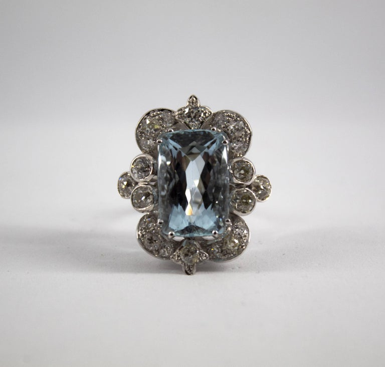This Ring is made of 18K White Gold. This Ring has 2.90 Carats of White Diamonds (Old Cut Diamond). This Ring has a 12.60 Carats Aquamarine. Size ITA: 17 USA: 8 We're a workshop so every piece is handmade, customizable and resizable.
