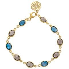 12.62 Carat Blue Topaz and Smoky Quartz 18 Karat Yellow Gold Bracelet