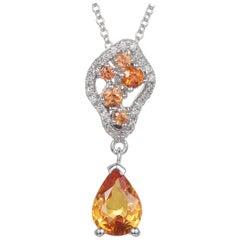 1.27 Carat Yellow Sapphire, Orange Sapphire, and Diamond Pendant 14 Karat Gold
