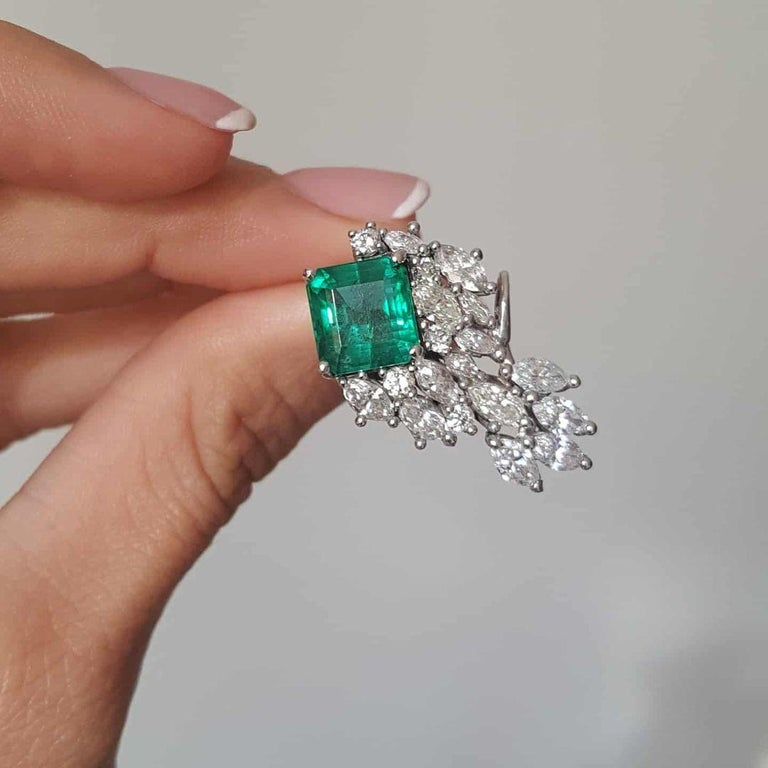 Made in Italy by our expert goldsmith this 12,79 carats climber earrings have the highest quality natural emeralds with VS clarity deep intensify green color and great luster, they weight total 6,79 carats.   They come with a gemmologist certificate