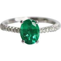 1.28 Carat OVal Cut Green Emerald and Diamond Ring