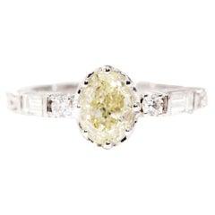 1.29 Carat GIA Certified Oval Yellow Diamond 18 Carat White Gold Engagement Ring