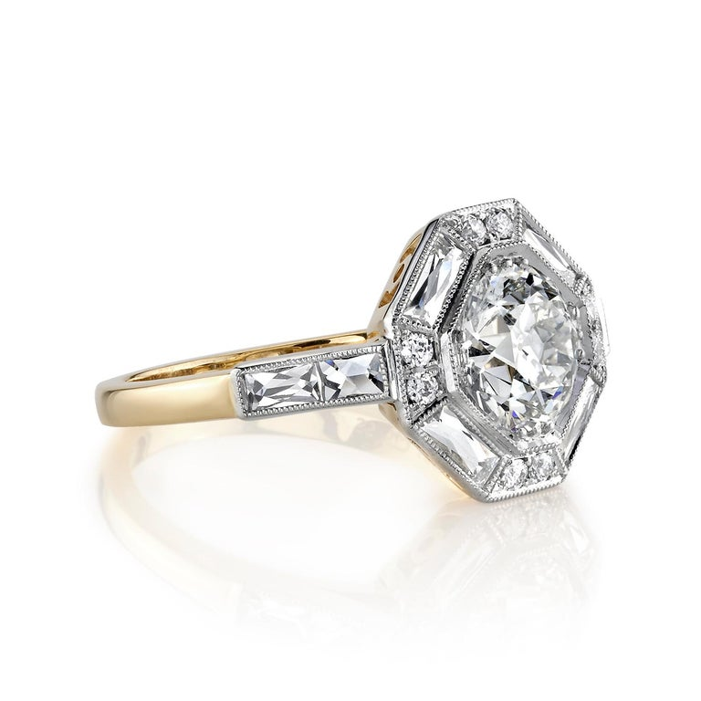 1.29ctw I/VS2 GIA certified old European cut diamond with 0.30ctw mixed cut accent diamonds set in a handcrafted 18K yellow gold and platinum mounting.  Ring is currently a size 6 and can be sized to fit.
