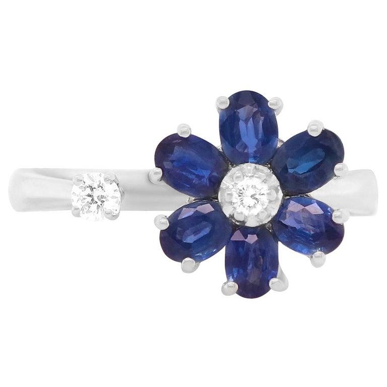 1.29 Carat Oval Blue Sapphire and Diamond Flower Toi et Moi Ring 14 Karat Gold For Sale