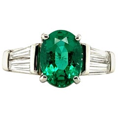 1.29 Carat Oval Emerald and Graduated Baguette Diamond Ring