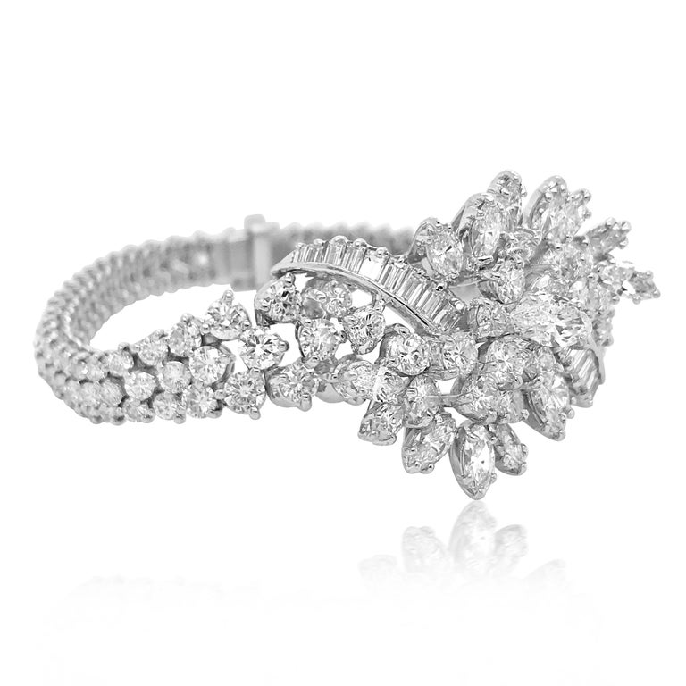 This captivating diamond bracelet of sophisticated elegance and outstanding workmanship is crafted in solid platinum, weighing 49.38 grams and measuring 17.2cm (6.7 inches) long. It incorporates a pair of very precious floral bouquets, composed of