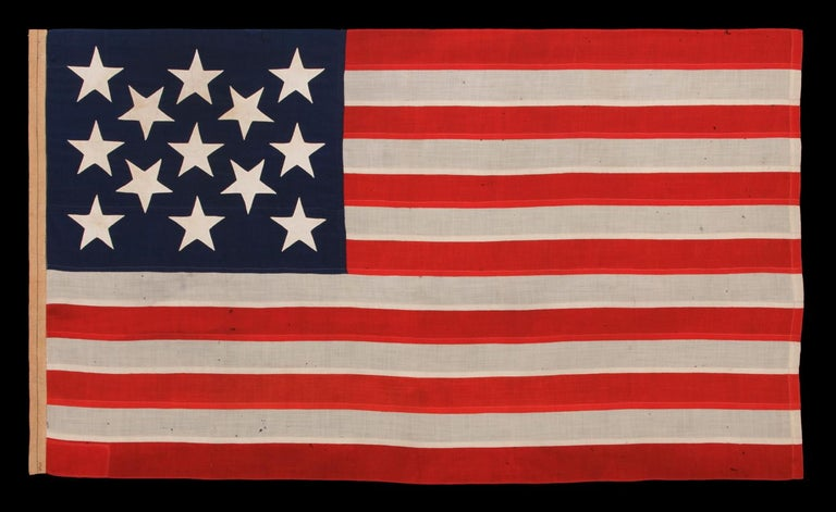 13 enormous, hand-sewn stars on a U.S. Navy small boat ensign, circa 1890-1899, an extraordinarily beautiful example in a remarkable state of preservation 