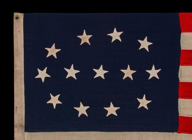 American 13 Hand-Sewn Stars in a Elliptical Medallion Pattern, Civil War Era For Sale