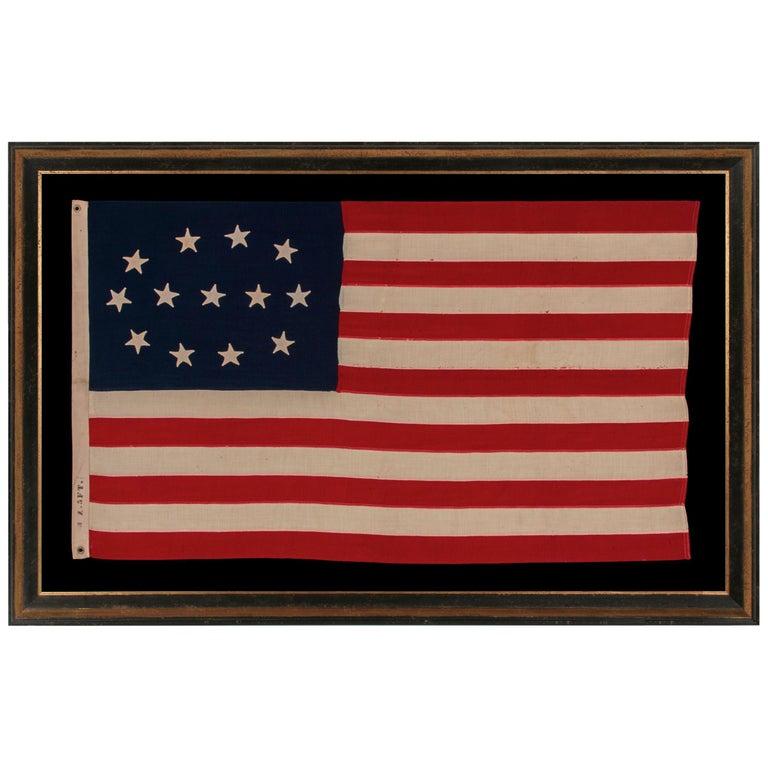 13 Hand-Sewn Stars in a Elliptical Medallion Pattern, Civil War Era For Sale
