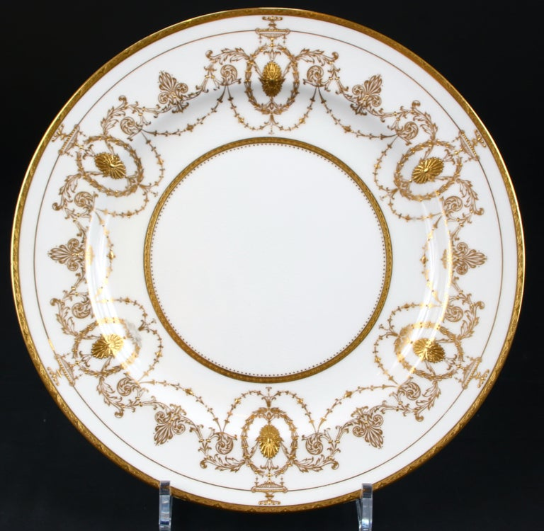 Antique Minton, Stoke-on-Trent, England, Adam-style plates, feature encrusted medallions and urns linked by foliate swags with s gold beading, Pattern H528, one of Minton's famous