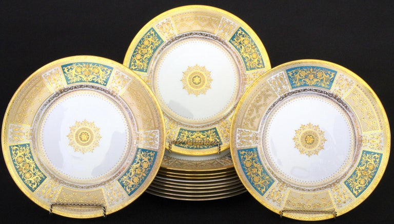 This set of Minton, Stoke-on-Trent, England, master-gilder service or dinner plates feature six 22-karat gold-beaded panels, three cream and three turquoise, each decorated with ornate and elaborate ornaments composed of flowers, laurel, lotuses,