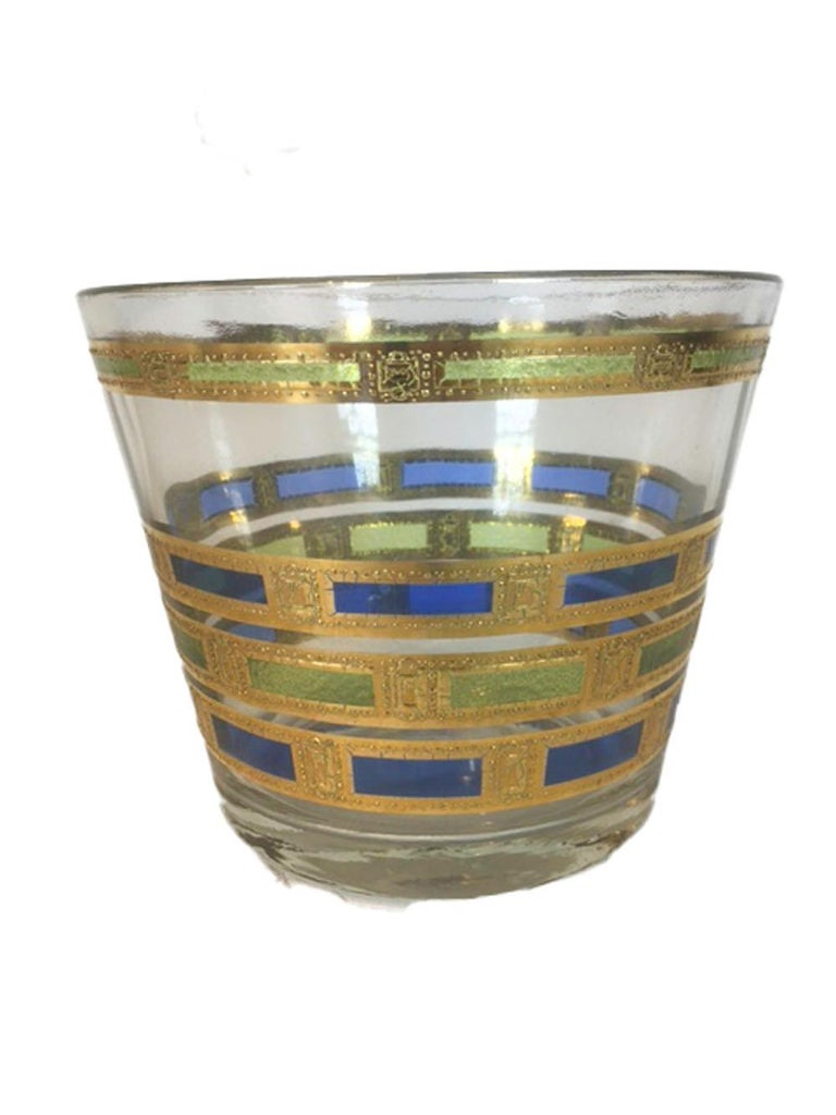 Vintage culver glassware, 13 piece barware set in the Empress pattern. Including 1 ice bowl, 6 highball & 6 rocks glasses, all decorated with bands of blue and green translucent enamels with 22-karat gold.  Measures: 1 - Ice bowl: 4-3/4