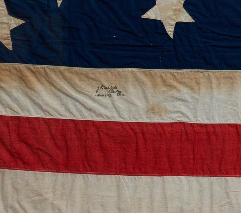 Presented is a bright 13-star handcut American Flag, signed by J.L. Wakefield from Preston, Ohio and dated November 10, 1884. This flag's canton features the highly sought-after medallion star pattern, with one large central star, encircled by a