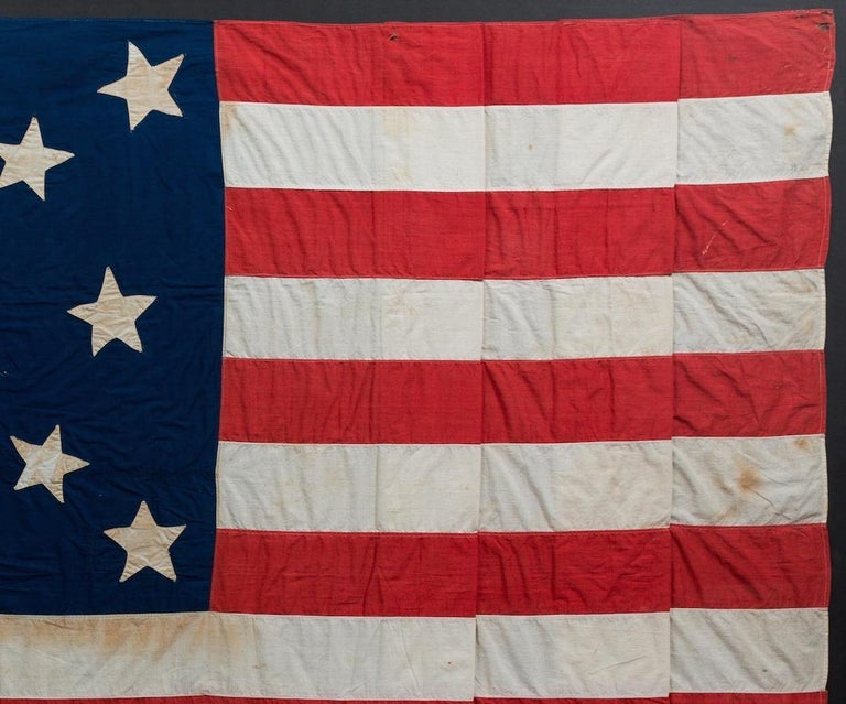 Late 19th Century 13-Star American Flag, Handcut Medallion Pattern, Signed by Maker, 1884 For Sale