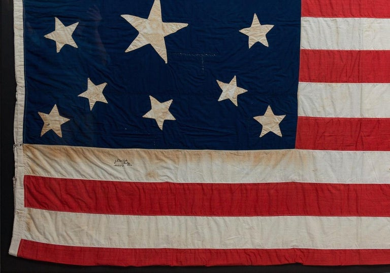 Cotton 13-Star American Flag, Handcut Medallion Pattern, Signed by Maker, 1884 For Sale
