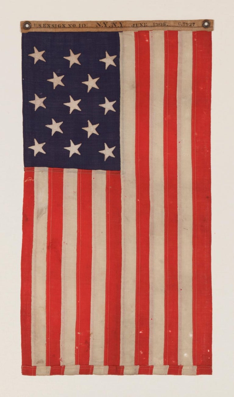 13 Stars, a United States navy small boat ensign made at the Brooklyn Navy Yard, New York, signed and dated 1906:   13 star American national flag of the type used by the U.S. Navy on small boats around the turn-of-the-century. These flags were