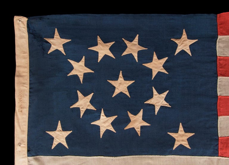 13 STARS IN A BEAUTIFUL MEDALLION CONFIGURATION ON A SMALL SCALE ANTIQUE AMERICAN FLAG MADE DURING THE LAST QUARTER OF THE 19TH CENTURY:  13 star American national flag, made sometime between the 1876 centennial of American independence and the