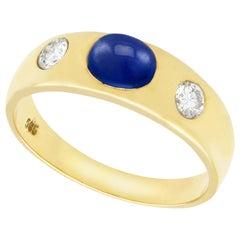 1.30 Carat Blue Sapphire and Diamond Yellow Gold Three-Stone Ring