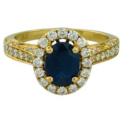 1.30 Carat Oval Blue Sapphire and Diamond Halo Diamond Ring in 18 Karat Gold