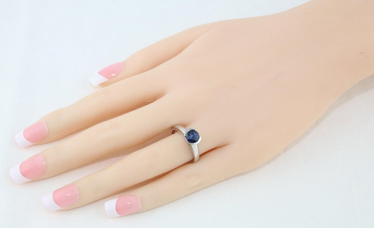 Contemporary 1.30 Carat Round Blue Sapphire Half Bezel Solitaire Gold Ring For Sale