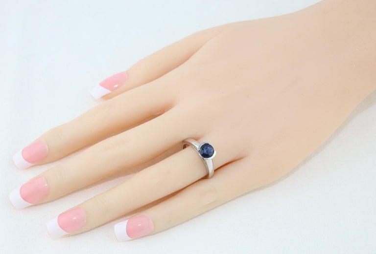 Women's 1.30 Carat Round Blue Sapphire Half Bezel Solitaire Gold Ring For Sale