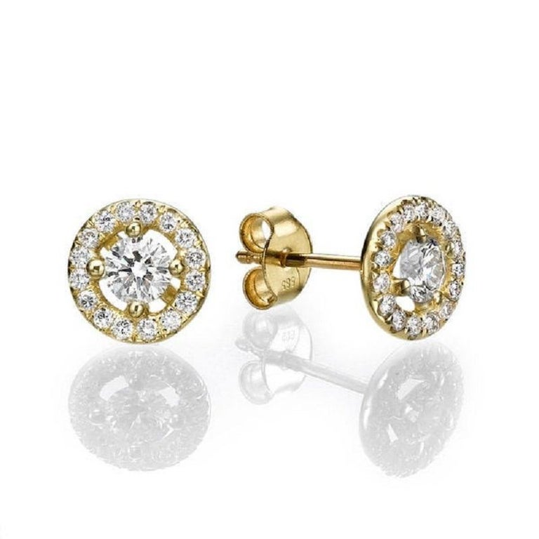 A beautiful Diamond stud earrings made of 14K Yellow Gold set with a pair of excellent Round cut Diamond of SI1 clarity and F color accented by 30 natural round diamonds. The total carat weight of these Diamond studs is 1.30 carat.      Center