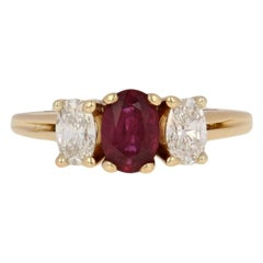 1.31 Carat Oval Cut Ruby and Diamond Ring,14 Karat Yellow Gold Cathedral Mount