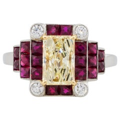 1.31 Carat Rectangle Shape Diamond Center Ring with Rubies Platinum in Stock