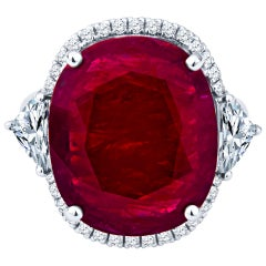 13.12 Carat Oval Cut Natural Ruby and 1.26 Carat Diamond Ring in 18 Karat Gold