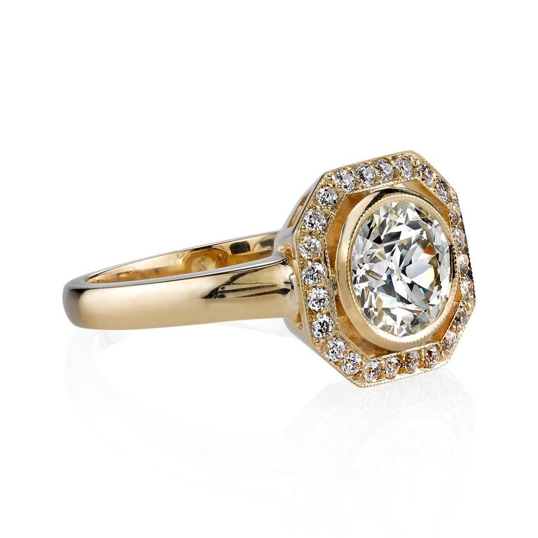 1.33ct L/VS1 GIA certified Old European cut diamond set in a handcrafted 18k yellow gold mounting. The center stone is set an octagonal millgrained head with 0.19ctw old European cut accent diamonds.   Ring is currently a size 6 and can be sized to