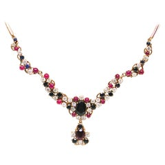 13.30 Carat Yellow Gold Diamond Ruby Sapphire Necklace