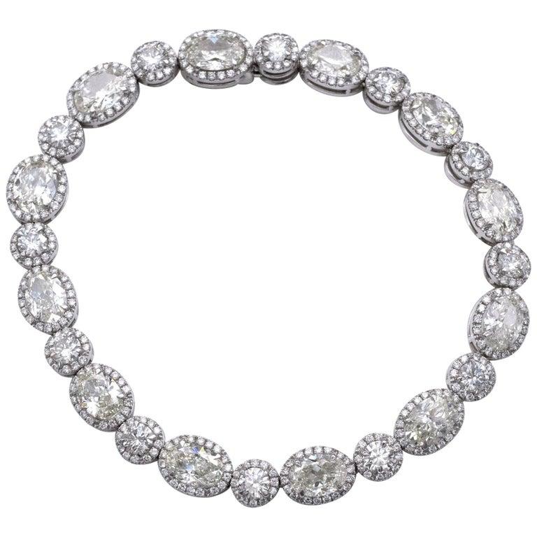 13.36 Carat Oval and Round Diamond 18 Karat Gold Tennis Bracelet For Sale