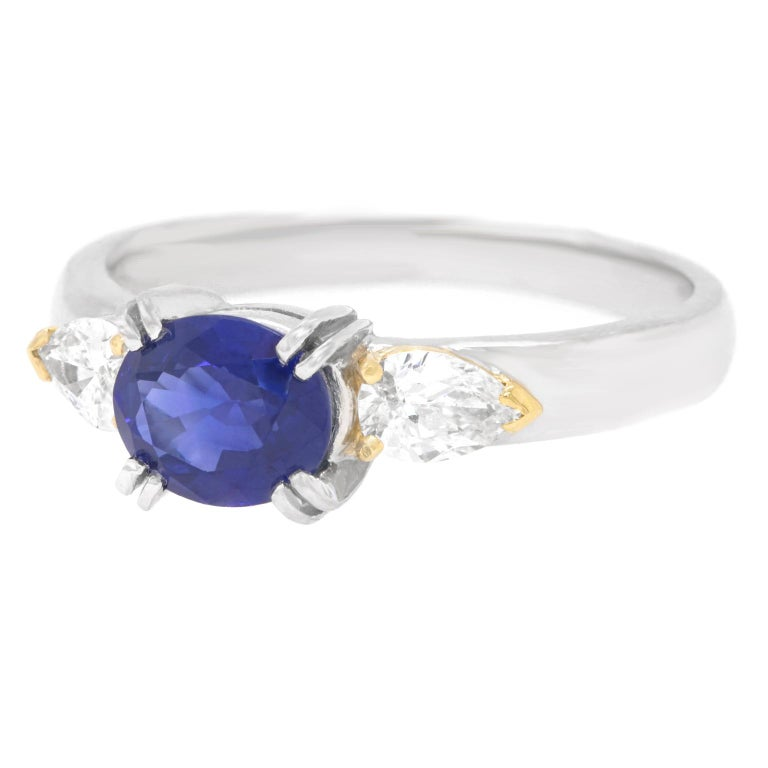 Oval Cut 1.33 Carat Sapphire and Diamond-Set Platinum Ring For Sale