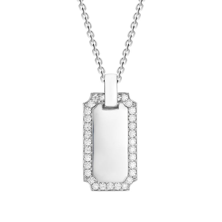 This large diamond ID tag pendant is handcrafted in lustrous 18-karat white gold. The outside rim is set with brilliant round cut diamonds which total 1.34 carats. The frame measures to 3.5cm in length and 1.8cm in width.  Chain length 22 inches.