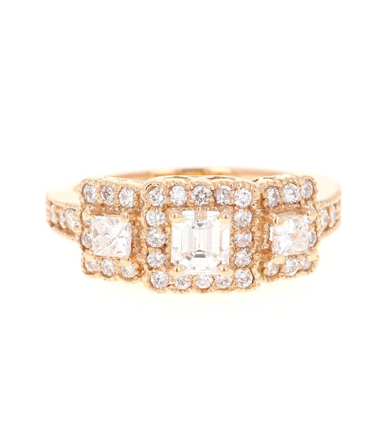 A beautiful 3-stone Diamond ring set in Rose Gold.  The center diamond is a Radiant Cut Diamond and weighs 0.53 carats. The clarity and color of the center diamond is VS-F. Adjacent to the center diamond are 2 Princess Cut Diamonds weighing 0.29
