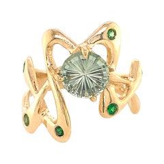"1.34 Carat Montana Sapphire ""Squibble"" Ring with Tsavorites in 18 Karat Gold"