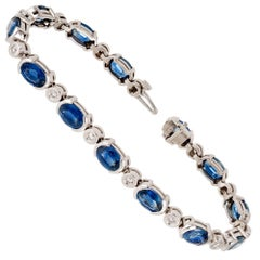 13.40 Carat Oval Blue Sapphire Diamond Tube Set Gold Bracelet