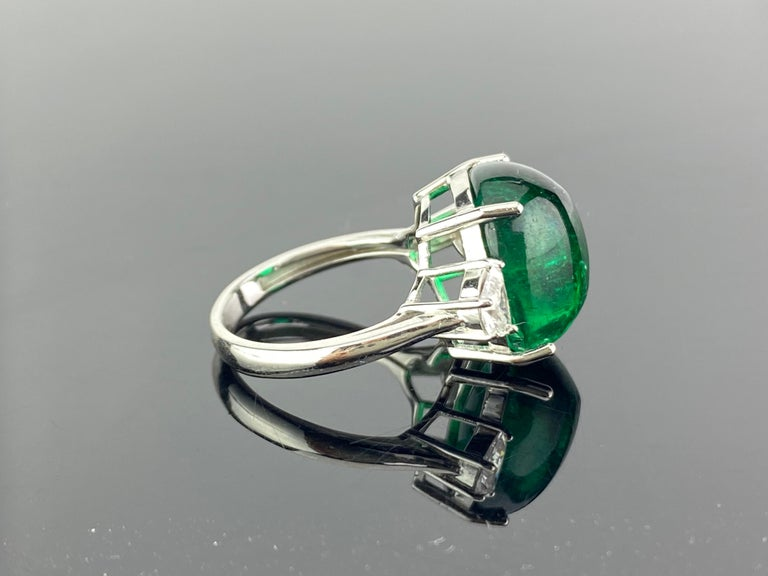 A unique 13.47 carat sugarloaf Zambian Emerald,  three stone engagement ring, with 2 half-moon side stone diamonds. The emerald is of great lustre and has an ideal colour. All set in 18K white gold. Currently a ring size US 6.5, but we can resize
